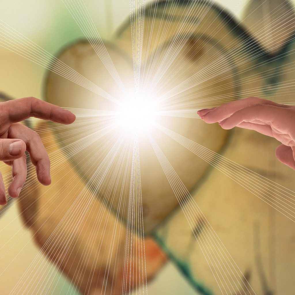Hands touching each other on heart background