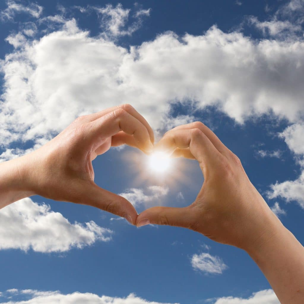 Heart shape in sky with hands marriage