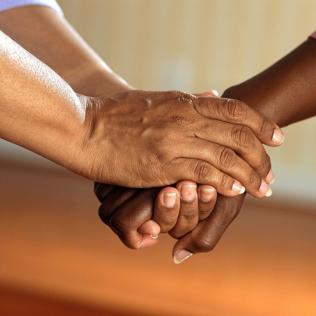 Helping hands holding - compassion