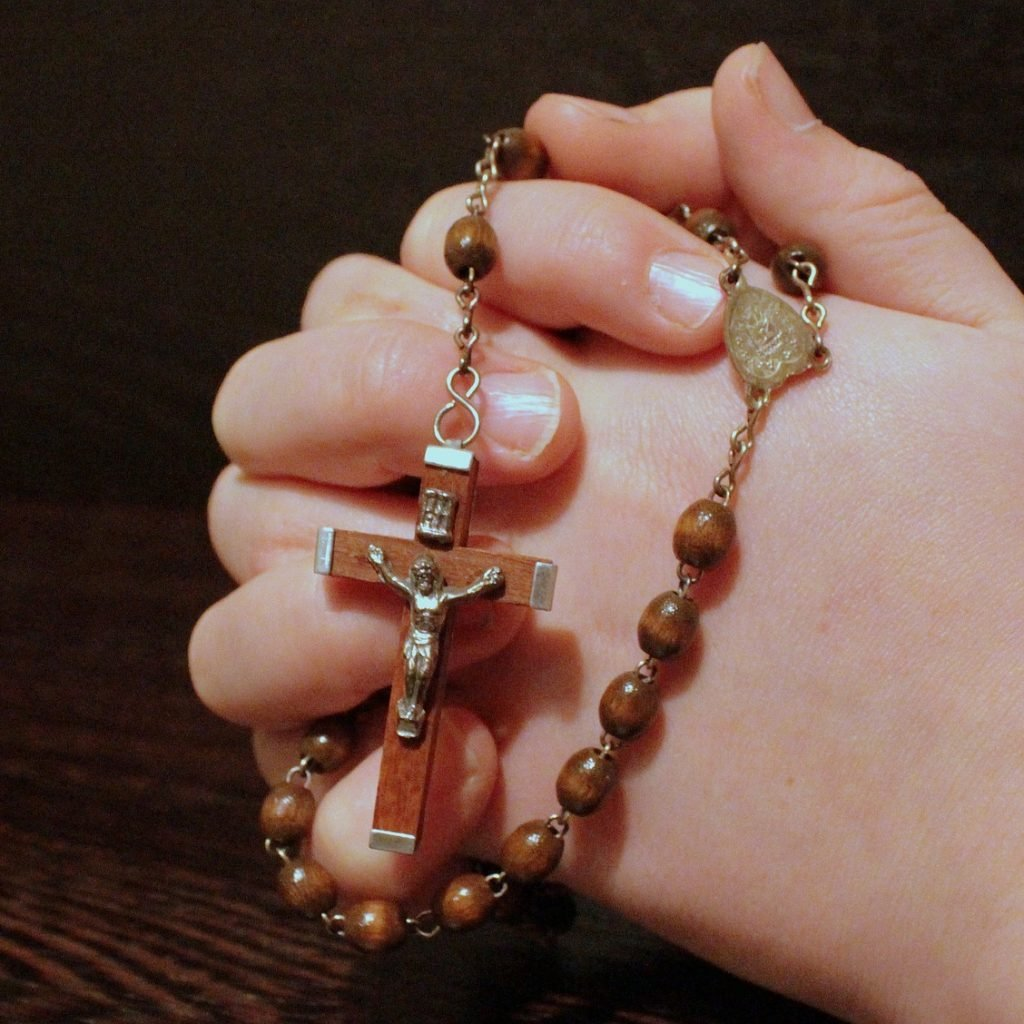 Person pray in faith and forgiveness