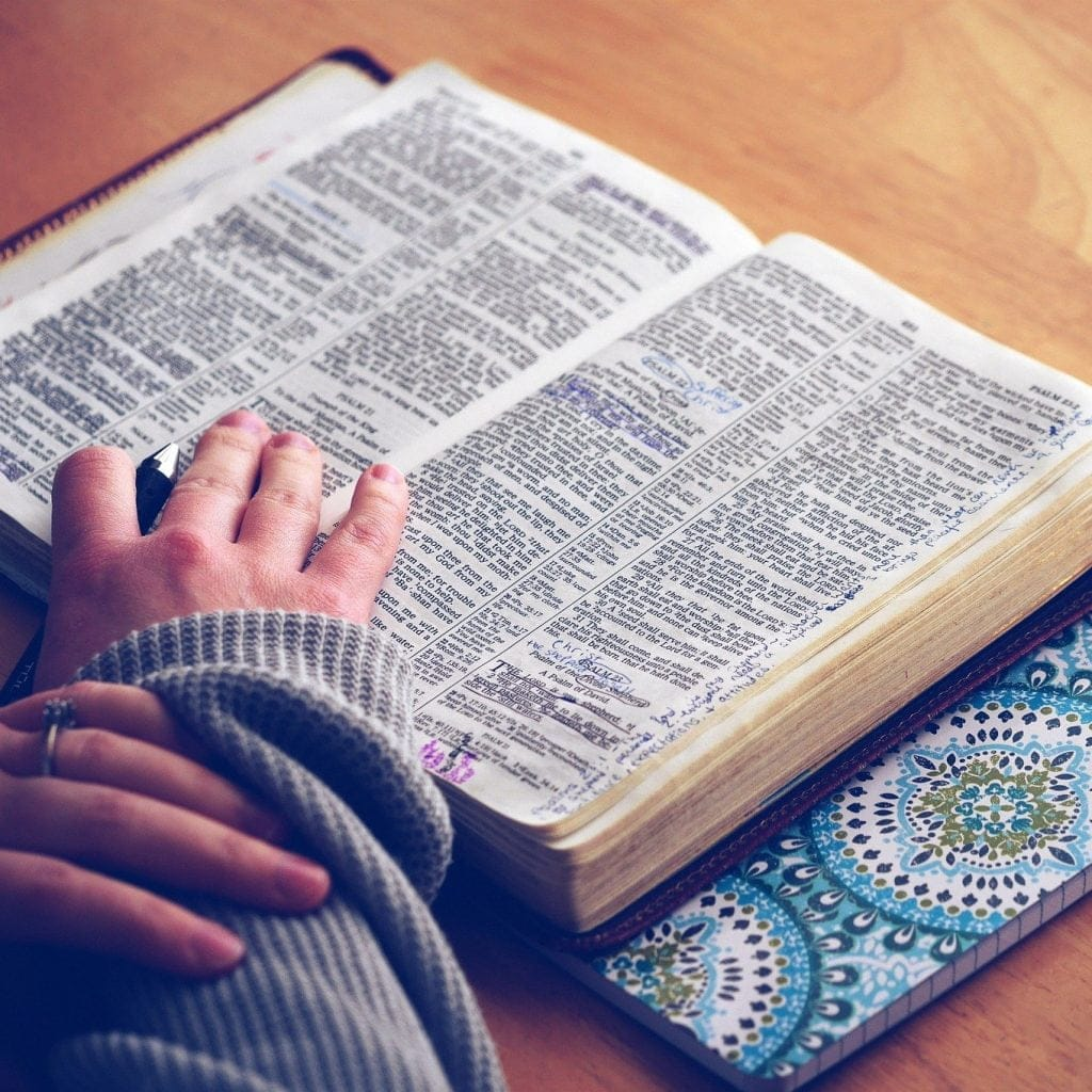 Hand on the Bible pages
