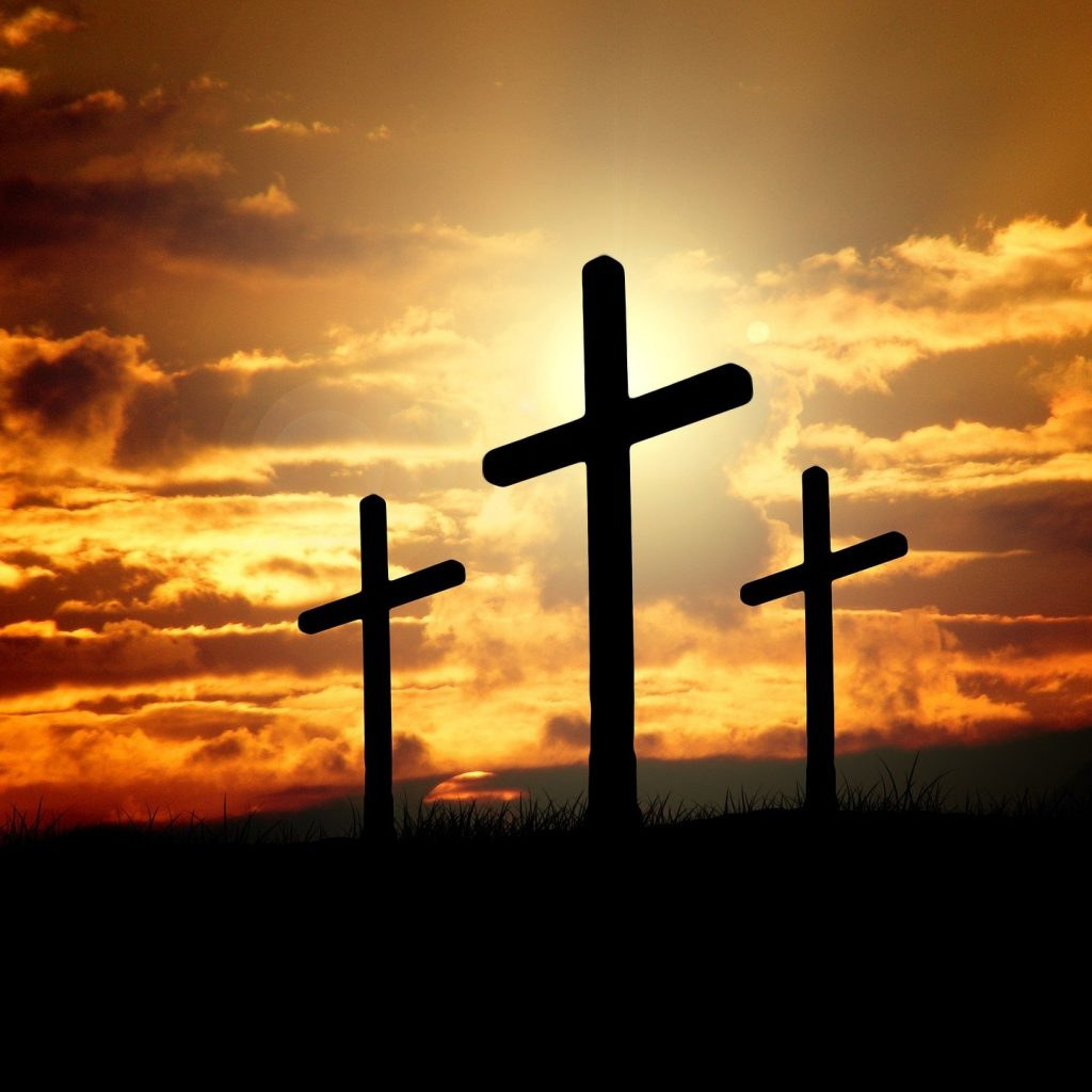 Three crosses planted on a piece of land