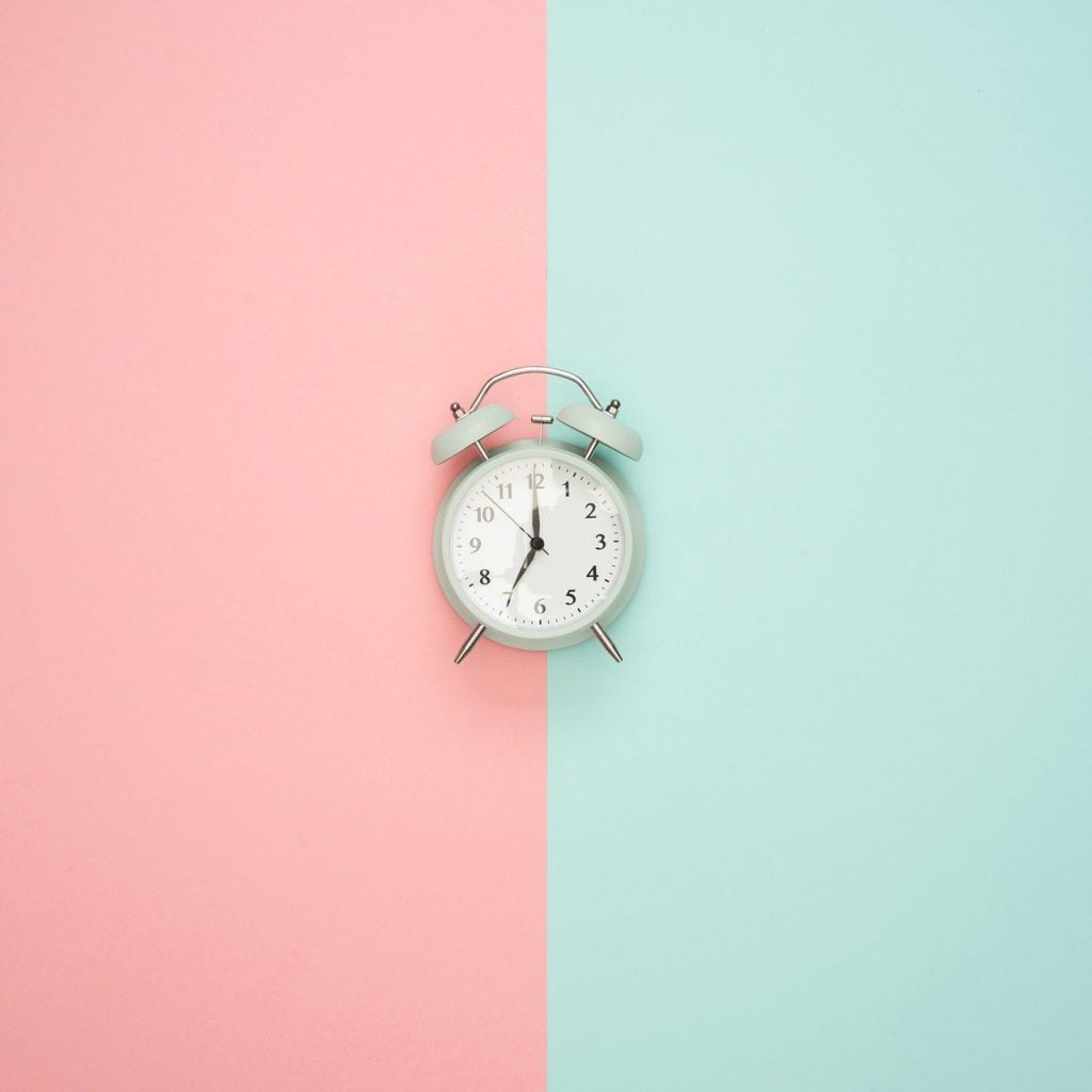 Small clock on green red background