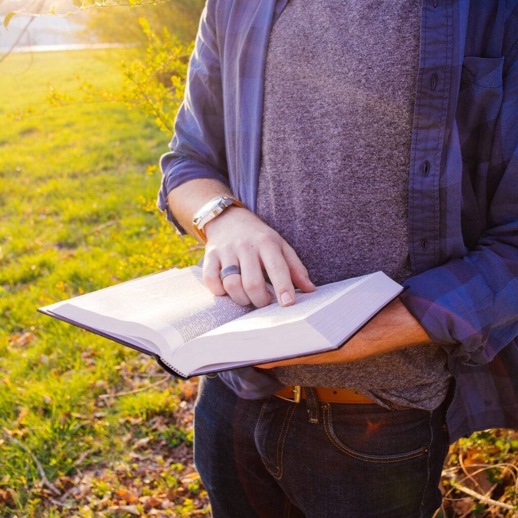 Man reading from the Bible word of God