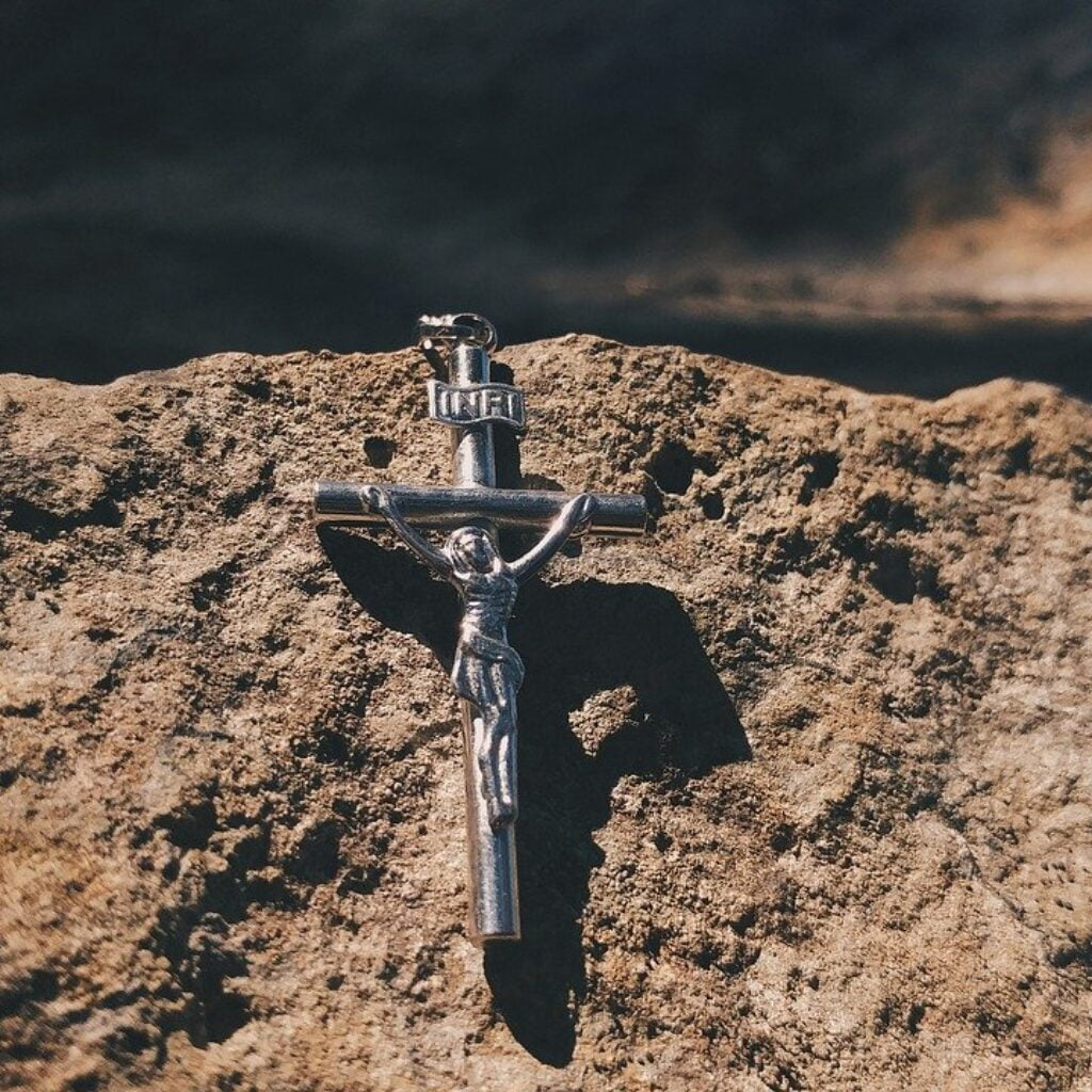 An emblem of the cross on a stone