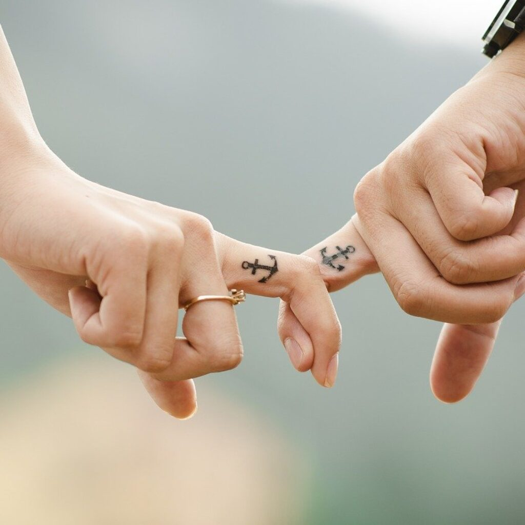 A couple's fingers tattoo with anchors - can we go to heaven with tattoos