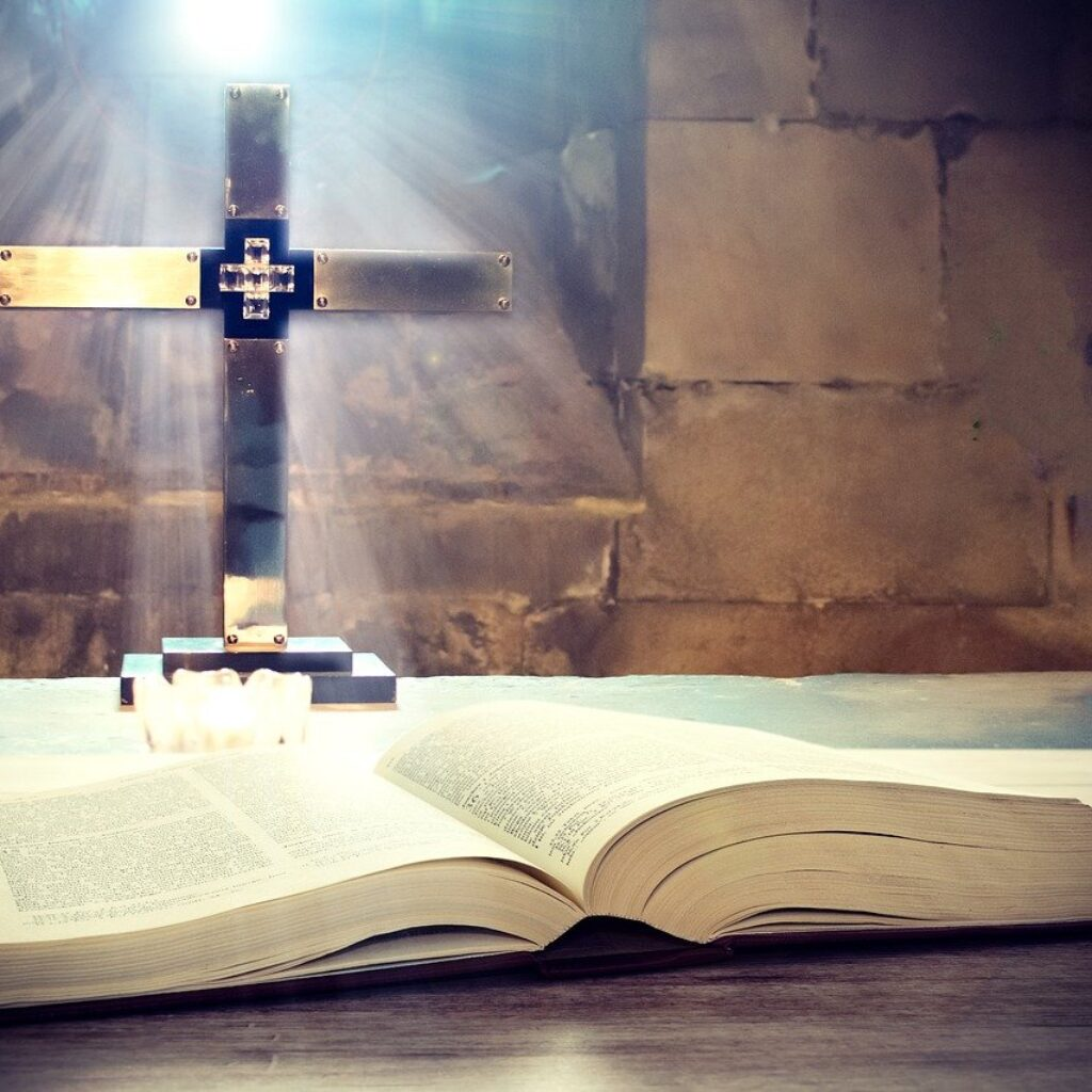 cross and the Holy Bible in a church