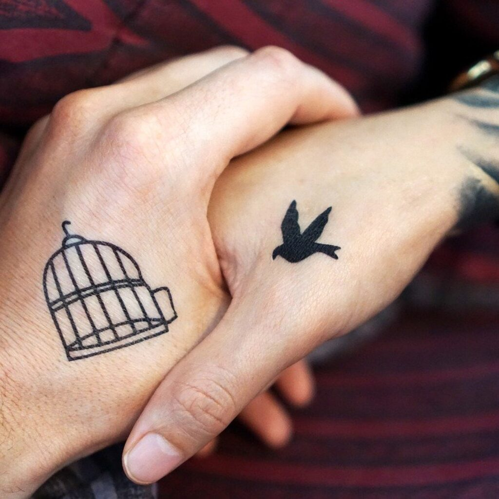 can you go to heaven with tattoos - A couple holding hands